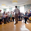 "BRYAN EATON/Staff Photo. Bresnahan School students sing ""Dreidel Song"" along with other seasonal music to the delight of the senior citizens."