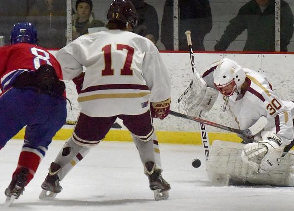 BRYAN EATON/Staff Photo. Newburyport goalie Jamie Brooks makes a save on a shot by Burlington's Sean Malone.