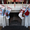 BRYAN EATON/Staff Photo. Christmas stockings on the mantle of the Weishaupt home.