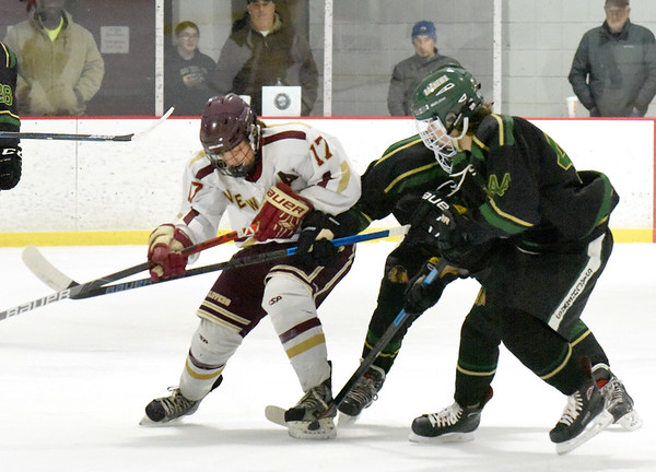 BRYAN EATON/Staff Photo. Newburyport's Tucker St. Lawrence and Pentucket's Ryan Soucy in action at the Graf Rink.