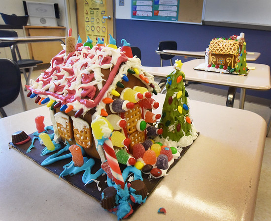 BRYAN EATON/Staff Photo. Amesbury High School students in teacher Collin Sullivan's math classes made gingerbread houses using geometry they learned.