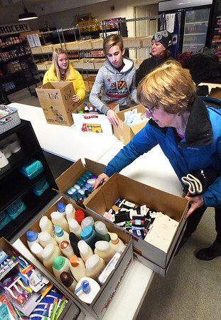 BRYAN EATON/Staff Photo. Newburyport's Nock Middle School students delivered toiletries and other necessary items to Community Service of Newburyport on Friday. The student council lead the drive to get donations from fellow student body of personal care items such as liquid dish soap, body wash, lotion, shampoo, conditioner, shaving cream, razors, deodorant,toothbrushes, hairbrushes and combs to the service organization created in 1912 and also has a food pantry and other services to those in need.