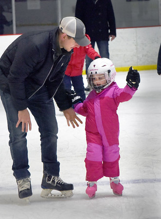 BRYAN EATON/Staff photo. The Graf Rink in Newburyport has been busy over school vacation and is probably safer spot to skate than area ponds as the temperatures have been well above freezing. Lyla McElroy, 4, of Newburyport with her dad Kyle spotting, started to lose her balance then took a spill and like falling off a horse, she got right back up to skate some more.