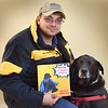 BRYAN EATON/Staff Photo. Donald Jarvis has written a book about his service dog Mocha.