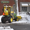 BRYAN EATON/Staff Photo. A worker with the Newburyport DPS clears sidewalks in the downtown area on Monday afternoon. The work will likely be repeated today as more snow was in the forecast for Monday night.