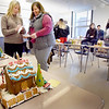 BRYAN EATON/Staff Photo. Amesbury High School students in teacher Collin Sullivan's math classes made gingerbread houses using geometry they learned. Judging the creations are Amanda Kennedy, special education facilitator, left, and special education director Lynn Catarius.