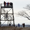 BRYAN EATON/Staff Photo. The Hellcat Swamp observation tower at the Parker River National Wildlife Refuge was a busy spot on Thursday. The nearby interpretive trail was not as it's closed for renovation for likely a year.