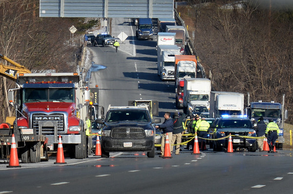 BRYAN EATON/Staff Photo. Traffic on the southbound side of Interstate 495 in Amesbury was down to one lane as state police investigated the scene Thursday afternoon. A state trooper working a traffic detail with a road crew was stabbed with the trooper shooting the suspect who was taken to a Boston hospital.