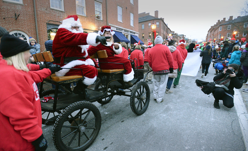 BRYAN EATON/Staff photo. Santa Claus waves to the crowd in Market Square in the Greater Newburyport Rotary Club's Santa Parade.