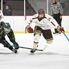 BRYAN EATON/Staff Photo. Jack Stewart heads for the ice as Newburyport's Declan Sullivan gets the puck.