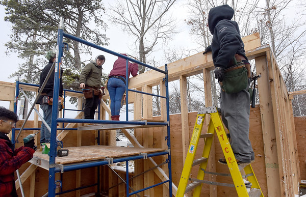 BRYAN EATON/Staff Photo. The crews frame the third building being built on Old County Road in Salisbury.