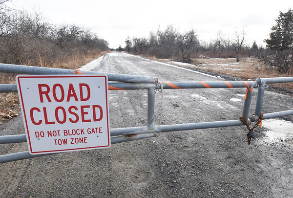 BRYAN EATON/Staff Photo. The road at Parker River National Wildlife Refuge is closed where it turns to gravel at the Hellcat Swamp parking lot.