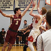 BRYAN EATON/Staff photo. Newburyport's Ryan Archie blocks Camden Keliher trying for two.