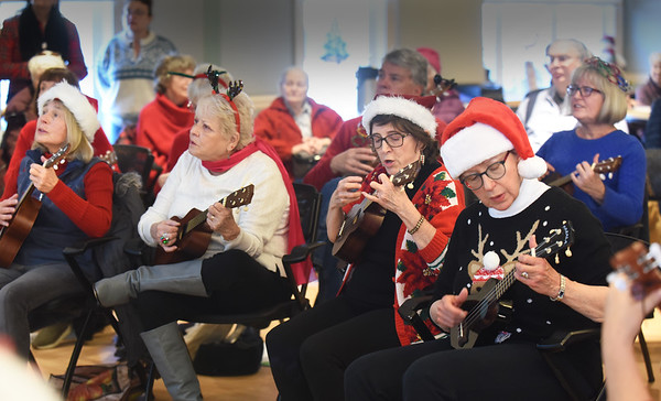 "BRYAN EATON/Staff Photo. Students from the Bresnahan School visited the Newburyport Senior and Community Center for a intergenerational celebration of the holiday season.  Here members of the ukelele class played ""White Christmas"" before the students sang some songs with refreshments served after."