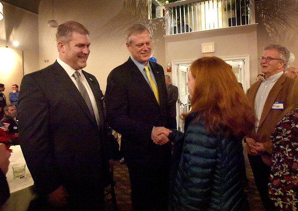 BRYAN EATON/Staff Photo. Gov. Charlie Baker greets Newburyport High School senior Lucy Gagnon on Tuesday night at the Mission Oak Grill. He was attending a fundraiser for Rep. Jim Kelcourse, left.