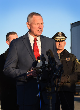 BRYAN EATON/Staff Photo. Amesbury police Chief Willliam Scholtz, right, listens as Massachusetts State Police Colonel Christopher Mason addresses the media.