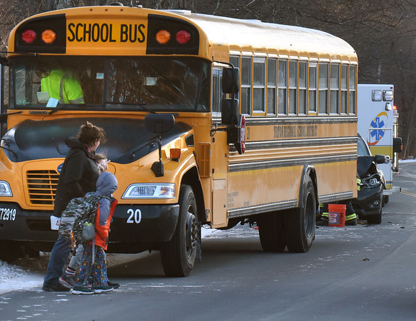 BRYAN EATON/Staff Photo. A school bus and car were involved in a collision late Thursday afternoon at Folly Mill Road and Elmwood Street in Salisbury. Police reported no injuries and parents were called to pick up their children while police investigated.