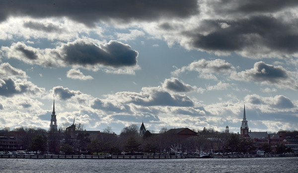 BRYAN EATON/Staff Photo. The wind whipped over the Newburyport skyline accompanied by dark clouds, though it remained dry. That should change as precipitation is forecast to be snow or a mix for Tuesday.