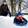 BRYAN EATON/Staff Photo. Clipper Cohen, 5, of Plum Island gets a push from his dad, Joseph, as he and scores of others enjoy the snow at the March's Hill area in Newburyport.