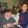 Karen Cameron Photo. World War II veterans were honored at the Annual Christmas Dinner, sponsored by the VFW Post 2016 at the Holy Family Parish Hall in Amesbury on Friday night.  Arthur Biebeau, World War II veteran, receives a gift card from <br /> Julien Touhey-Childres.