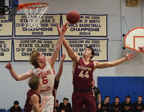 BRYAN EATON/Staff photo. Amesbury's Kyle Donovan and Peter McLaren battle for a loose ball.