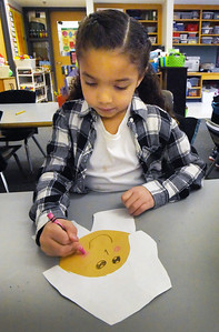 BRYAN EATON/Staff Photo. Aubrie Madigan, 6, works on a portrait of Sarah Morton in Jane Keeler's kindergarten class recently. Morton was born in Holland and arrived at Plimoth Plantation in 1623 when she was five years-old and the students were learning of the life of the young girl growing up in colonial times.