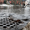 BRYAN EATON/Staff Photo. Rain and melted snow drain in Market Square in Amesbury late Monday morning as the temperture went to the low 50's. More rain is in the forecast possibly turning to snow Tuesday night into Wednesday morning with clearning and cold for Thursday.