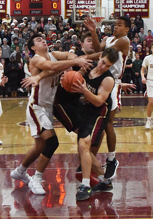 BRYAN EATON/Staff photo. Parker McLaren scrambles with a BC High School player for the rebound.