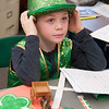 JIM VAIKNORAS/Staff photo Liam Timmons shows off his Irish heritage at the Salisbury Elementary School 2nd grade Passport to Learning Friday afternoon. Each 2nd grader at the school made a display and gave a short presentation about their ethnic heritage.