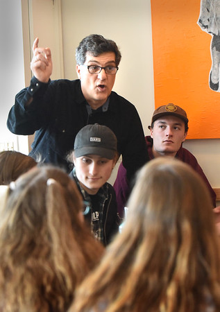 BRYAN EATON/Staff photo. Teacher John Giordano facilitates a group of students and adults on ways to protest school shootings at a meeting at the Commune in Newburyport.