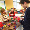 BRYAN EATON/Staff photo. The New Hampshire Society for the Prevention of Cruelty to Animals spoke to third-graders at the Newbury Elementary School recently and the class decided to do some fundraising for the group. They held a sale Wednesday afternoon where they made bracelets, necklaces and book markers. Checking out the items made by Ava Valianti, 8, left, and Annie Jacobsen, 9, is Joshua Krugman, 11.