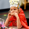 BRYAN EATON/Staff photo. Autumn Shamano, 5, bites into cookie at a combination 100th day of school and Valentine Party in Jane Keeler's kindergarten class at Salisbury Elementary School. The youngster made capes like Zero the Hero wears with 100 stars or hearts decorated on eachg one.