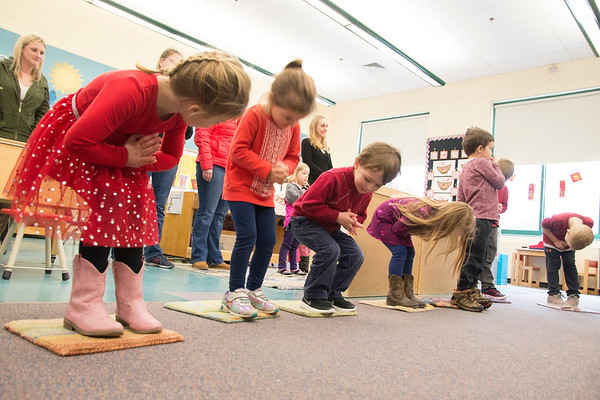 """JIM VAIKNORAS/Staff photo Students in Mary Jo Lagana's pre-school class. at the Newbury Elementary School sing a song about Chinese New Year. The bow when the sing """" Hung Hay Fat Choy"""" which mean Happy New Year."""