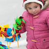 JIM VAIKNORAS/Staff photo Rosie Shwom, 15 months, checks out the pin wheels at the annual West Newbury Winter carnival at Mill Pond Saturday.The event included sledding, skating, hockey, food, music and a visit from Frosty and the Cat in the Hat.