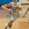 JIM VAIKNORAS/Staff photo Triton's Jack Tummino drives to the basket against Lynnfield at Triton Friday night.
