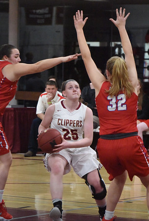 BRYAN EATON/Staff photo. Newburyport's Anna Hickman gets pressure from Tewksbury and is fouled on this drive.