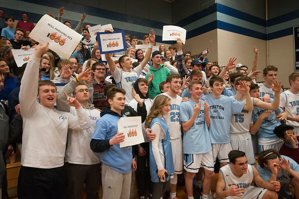 JIM VAIKNORAS/Staff photo Triton's Will Parsons, #23 is surrounded by his classmates and teammates after scoring his 1000 career point during the Viking game against Lynnfield Friday night.