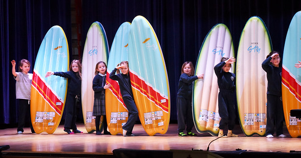 "BRYAN EATON/Staff photo. Kindergartners perform a dance number to the Beach Boy's ""Surfin' USA"" during a talent show at the Immaculate Conception School in Newburyport on Thursday morning. They also performed a show at night for parents, part of Catholic Schools Week."