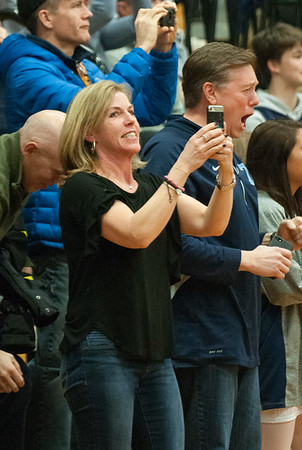 JIM VAIKNORAS/Staff photo Lynn and Roger Parsons react after their son Triton's Will Parson scores his 1000 career point against Lynnfield Friday night.