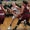 JIM VAIKNORAS/Staff photo Masconomet's Morgan Bovardi drives to the basket at home against Newburyport Friday night.