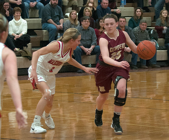 JIM VAIKNORAS/Staff photo  Newburyport's Anna Hickman is guarded by Mak Graves at Masconomet Friday night.