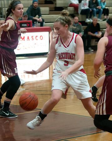 JIM VAIKNORAS/Staff photo Masconomet's Paige Amyouny grabs a loose ball against Newburyport Friday night.