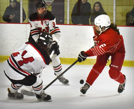 BRYAN EATON/Staff photo. Masco forward Shannon Brennan tries to stop the puck from getting to home side of the ice.