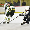 BRYAN EATON/Staff photo. Pentucket's Cameron Martin moves down the ice as Hamilton-Wenham's Aidan Daly moves in.