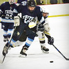 BRYAN EATON/Staff photo. Triton forward Kyle McKendry and Casey Langley vie for the puck.