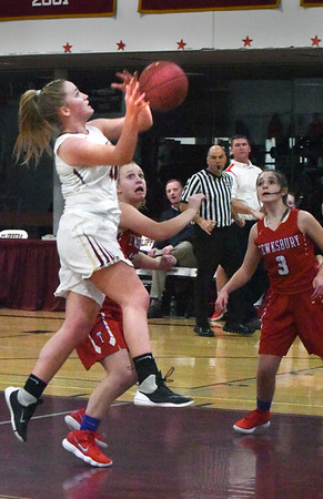 BRYAN EATON/Staff photo. Newburyport guard Katelyn Hadden is fouled by Tewksbury.