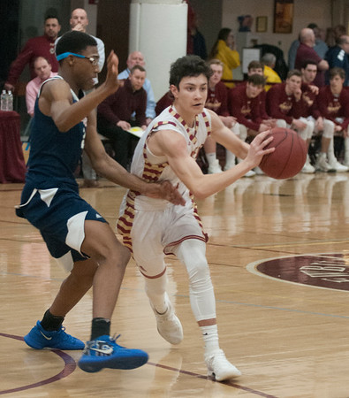 JIM VAIKNORAS/Staff photo Newburyport's Ryan Archie drives to the basket against Lynn Tech at Newburyport Tuesday night.