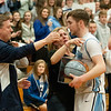 JIM VAIKNORAS/Staff photo Triton's Will Parsons hugs his parents Lynn and Roger Parsons after scoring his 1000 career point during the Viking game against Lynnfield Friday night.
