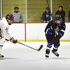 BRYAN EATON/Staff photo. Newburyport forward Matthew Marino-Babcock slaps the puck past a St. Peter-Marian player.