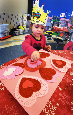 BRYAN EATON/Staff photo. Charlotte Robinson, 6, creates a large card for Valentine's Day which is next Wednesday. She was in art class at the Newburyport YWCA's Afterschool Program at the Bresnahan School on Tuesday.